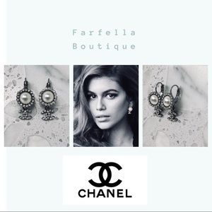 Authentic dangle Chanel earrings with faux pearls